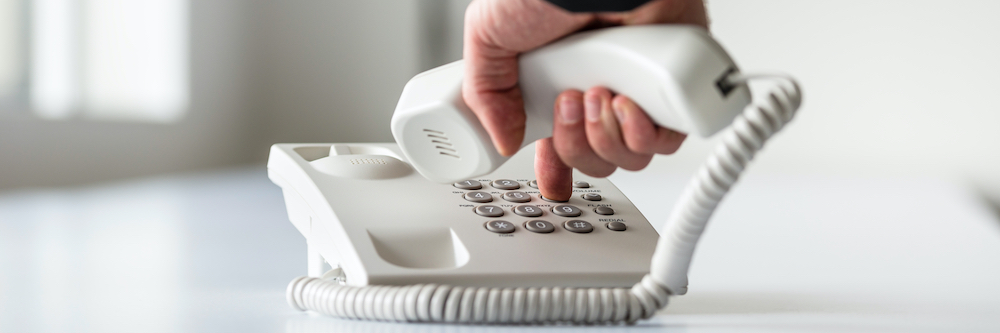 image of person dialing phone